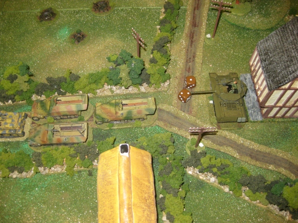 M10 fires into the darkness and scores no hits on the totally exposed rear column of Sd Kfz 251 halftracks.