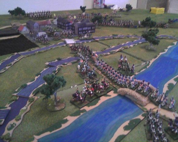 French sort out their bridge crossing procedure as the valiant Prussian cavalry try again to halt the moving mass.